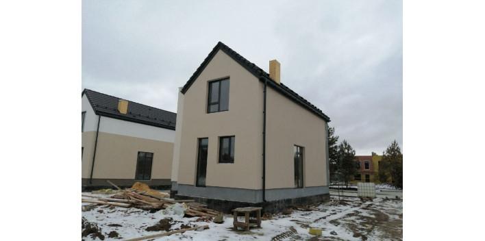 Двухэтажный кирпичный жилой дом площадью 140 кв.м